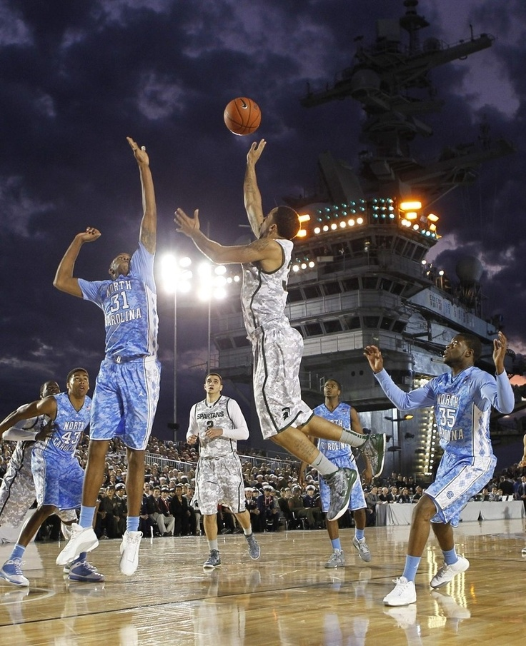 To mark Veterans Day, the Carrier Classic NCAA basketball game between North Carolina and Michigan State was held on the deck of the USS Carl Vinson in front of an audience of our military men and women. President and Mrs. Obama were in attendance, and they looked like they were having a blast. If you must know, North Carolina won, 67-55.