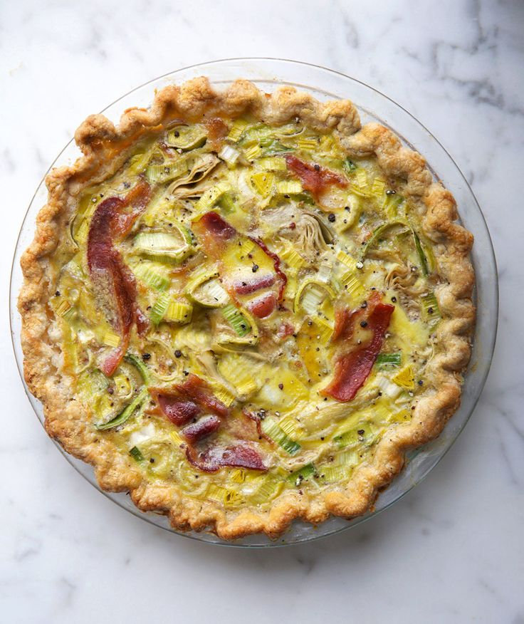 Artichoke, Leek, and Bacon Quiche | Quiche is one of those satisfying suppers that looks fancy, but is incredibly easy to prepare. This delicious version is great for breakfast, brunch, or dinner, and can be paired with a simple green salad to round out the meal. A pre-made pie crust simplifies the prep (and clean-up), making it ready to eat in less than an hour. In fact, the entire quiche can be prepared and refrigerated up to one day ahead, then warmed up in the oven when you're ready to…