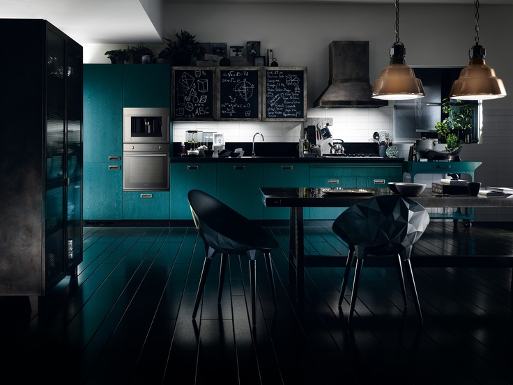 Diesel Social Kitchen design by Diesel | A ducted chimney hood with drip metal finish, has been created to a Diesel design | Exclusive Indigo tempera finish for the open-pore lacquered wood doors: the effect is similar to washed denim