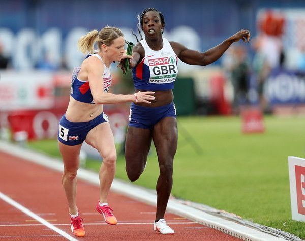 Eilidh Doyle of Great Britain takes the baton from team mate Anyika Onuora during the final of the womens 4x400m relay on day five of The 23rd European Athletics Championships at Olympic Stadium on July 10, 2016 in Amsterdam, Netherlands.