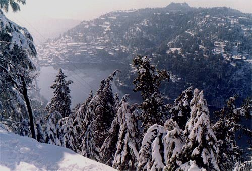 "Nainital, derived from the famous Naini lake, is a prominent place and has made its name by attracting hundreds of tourist from both domestic and international. It is also known as the ""Lake district of India"" and is located at an altitude of 1938metres. Nainital enjoys the most pleasant climate throughout the year with the maximum of 27degrees to a minimum of sub zero in winter. It is popular as hill station and has beautiful lakes surrounded."