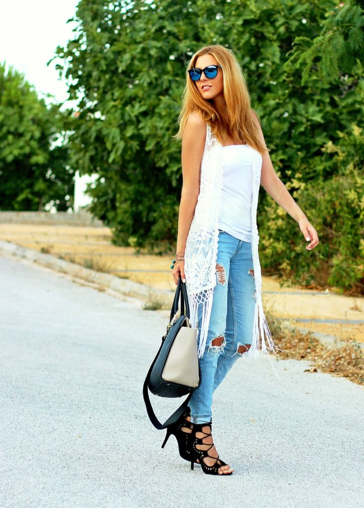 Knit vest and ripped jeans http://pearlsandrosesdiary.blogspot.gr/2015/07/young-and-free.html