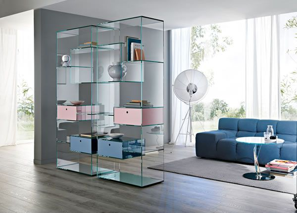 'Liber' From a single shape, the Liber system becomes many versatile elements, each with its own function: bookcase with mirror base, chest resting on glass feet and table that can be used as bedside table.