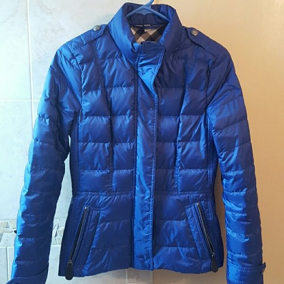 Super warm Burberry Brit Dalesbury Down jacket Burberry Authentic Brit Dalesbury Quilted Down blue Jacket in size small. Princess seaming and ruched side panels streamline a quilted down jacket styled with front zippered pockets. Hidden zip snap front. Snap tab cuffs with logo bottons. Ultralight weight. Gorgeous winter addition to your closet. Retail $695. I only wore it briefly at the end of last winter. Like new condition. Make me an offer if you love it! Can pull up receipt from…