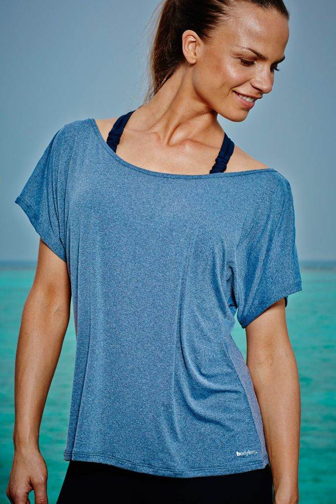Emma T-Shirt Grey and black Wear this soft-touch, off-the-shoulder t-shirt in or out of the gym for relaxed style and ultimate comfort. The quick-drying fabric will wick away any sweat from the skin and the soft fabric has a unique amount of stretch to allow a full range of movement. Ideal for layering.  Available now, £60.00 at http://www.bodyism.com/product/emma-t-shirt-ss15-grey/