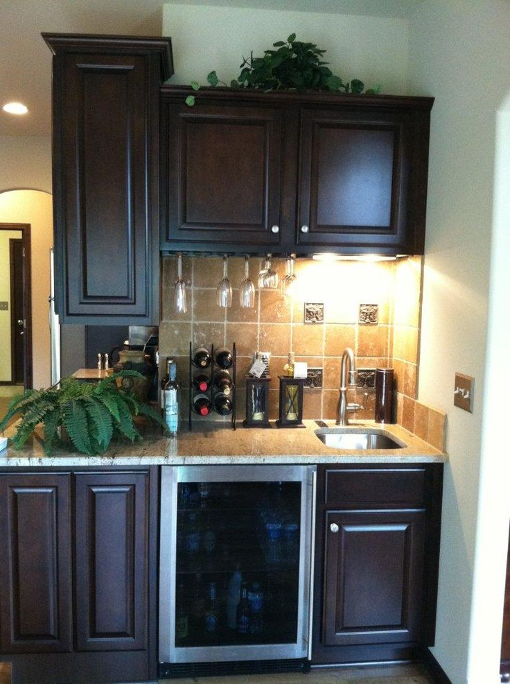 A Small Wet Bar Is Integrated Around The Corner Of This Kitchen. It Is Tied  Together Using Brown Tumbled Travertine Backsplash With Bronze Roman Fruit  ...