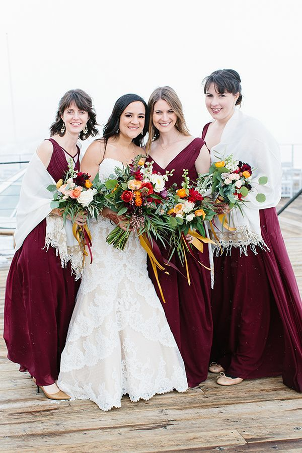 Jessica's bridesmaids wore burgundy chiffon dresses from Renz Rags and kept warm with hand-knit shawls from Elegance Scarf. | Photo by Sonya Yruel