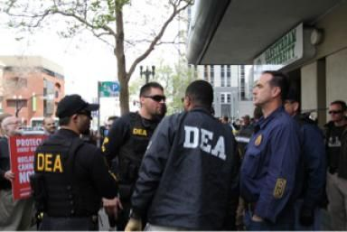 Explore DEA Agent Careers: U.S. Drug Enforcement Agents prepare to serve a warrant.  Image copyright Ryan Lackey 2012