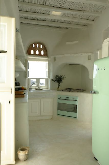 Oh my! I would move to Greece just for this kitchen. The ocean would just be a perk!