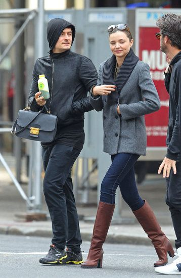 Love Miranda Kerr's style...always so sleek and polished. And I think it's too cute that Orlando Bloom is carrying her bag. <3