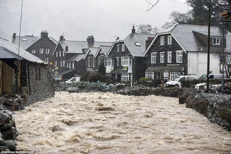 Here comes the rain from Storm Jonas: A torrent of water is seen flowing through the beck  in Glenridding this morning. The Cumbrian village flooded three times in December and is still recovering from the deluge - but faces further flash-flooding today and tomorrow