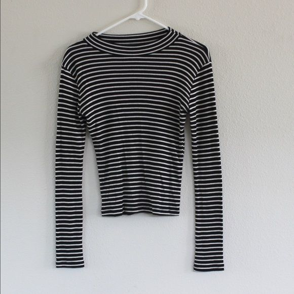Brandy Melville high neck striped shirt Ribbed black and white striped, high neck (not quite turtle neck), long sleeve top. Tight fitting depending on body. Never worn. Brandy Melville Tops