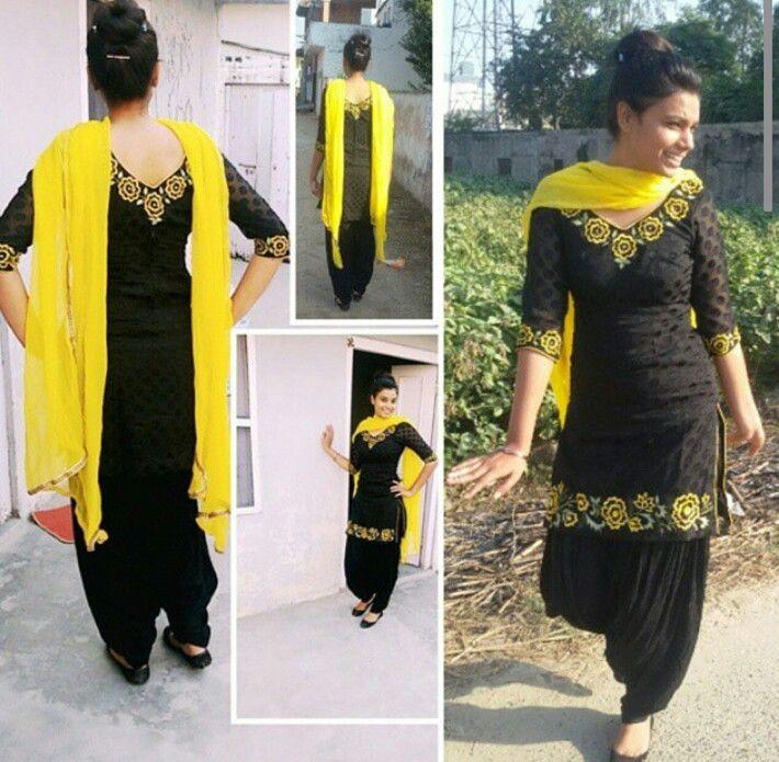 Punjabi black and yellow suit.