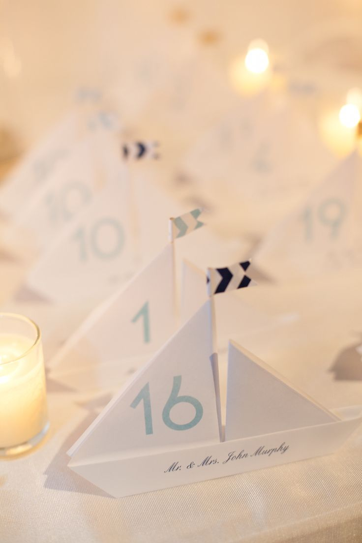 Boat seating cards. Photography: Deborah Zoe Photography - deborahzoephoto.com/  Read More: http://www.stylemepretty.com/massachusetts-weddings/2014/01/23/cape-cod-wedding-at-wequassett-resort-and-golf-club/