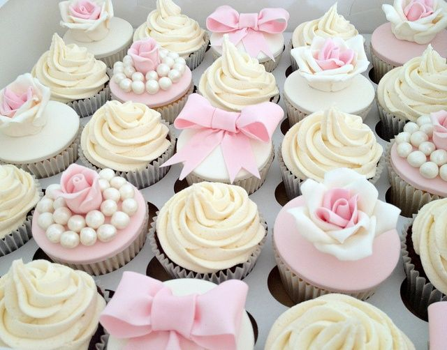 Cupcakes are fun!  But, this is great idea because you still have a wedding cake for your 1 year anniversary. @ http://JuliesCafeBakery.com #cupcakes #recipe #cakes