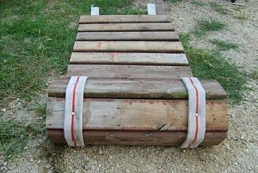 Roll-up sidewalk made from pallet wood and old fire hose.