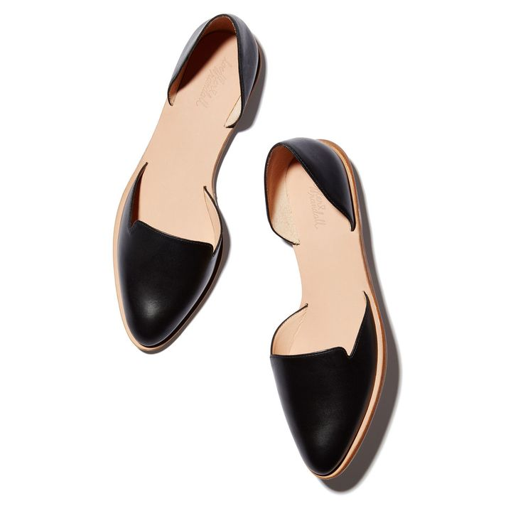 An architectural take on the classic little black flat, this calf leather version is a closet essential.