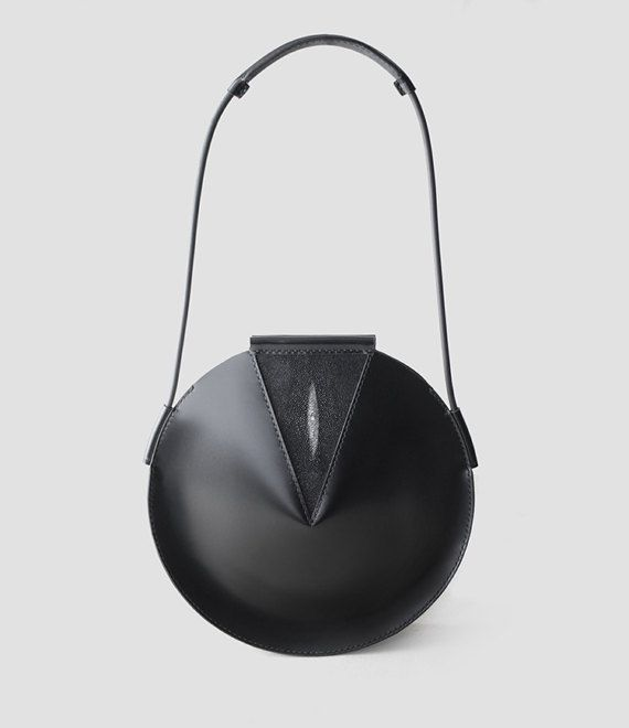 FREE SHIPPING BLACK FRIDAY + 25% OFFThis Nano bag comes packed with sublime seventies spirit. Curved to feminine perfection, this tiny piece is finished with shiny soft leather that effortlessly elevates outfits.   Solid shoulder strap  Top closure  Interior zip pocket  Inside cell phone