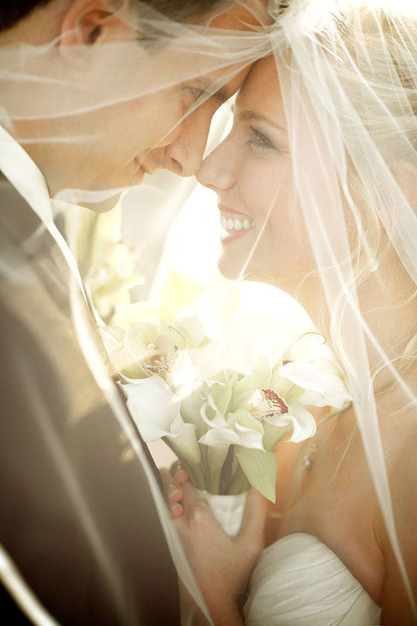 bride and groom through the brides veil