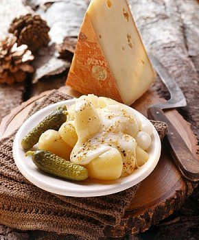 Swiss Raclette with boiled potatoes and gherkins