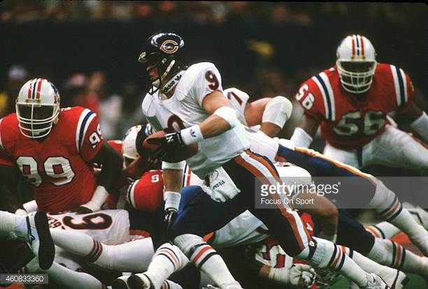 Jim McMahon of the Chicago Bears scrambles with the ball against the New England Patriots during Super Bowl XX January 26 1986 at the Louisiana...