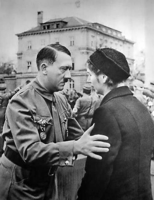 [500 x 650] Adolf Hitler speaking with a widow of a member of the Nazi party at the 1923 Beer Hall Putsch.