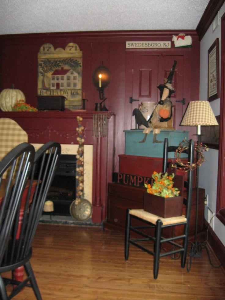Farmhouse interior living room harvest house designs for Primitive interior designs