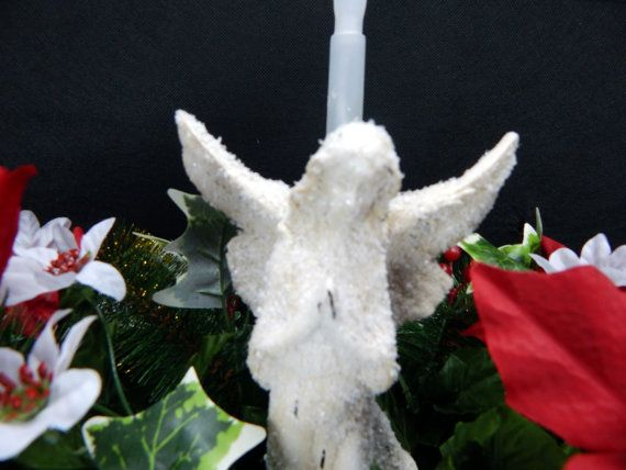 Beautiful Red Poinsettias Mixed With Holly & Berries Plus Glistening Christmas Angel & Solar Powered Flickering Candle Deluxe Headstone Saddle. (Saddle is approx. 29Lx17Hx15W) Displayed on a standard 36 double headstone, decorations are equally beautiful from any side. Solar