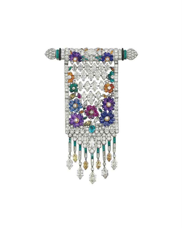 An Ar Deco Diamond, colored diamond and multi gem brooch.  Christies