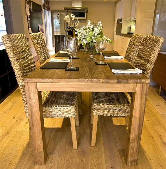 The 'Tutuk' Dining Set – a beautiful and unique, solid wood table made from reclaimed teak and four banana leaf chairs.