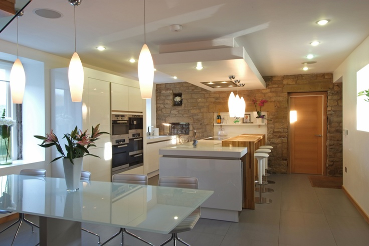 With great design a kitchen doesn't have to look like a kitchen, but a practical, light, ambient living space. The kitchen designers at Stuart Frazer will plan and install your kitchen to reflect your style and complement your home.