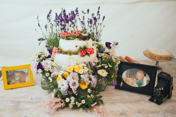 Home made wedding cake decorated with toadstools and lavender for a boho-style wedding.  Photo by Liz Wan Photography