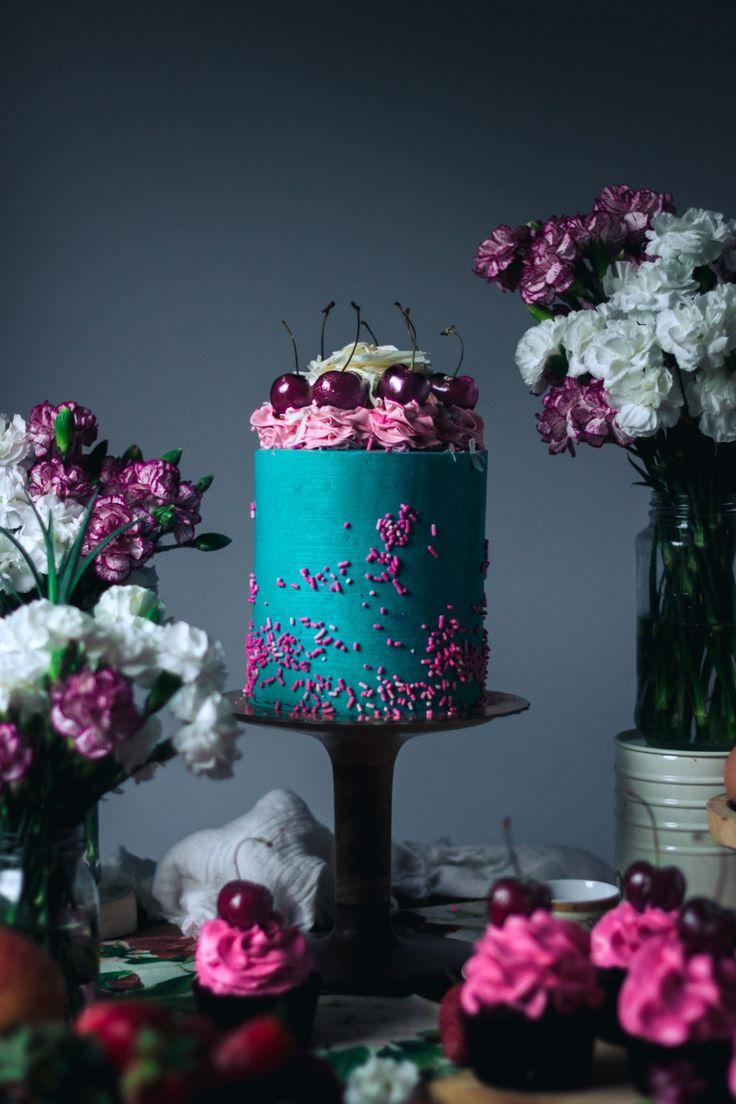 Whimsical wedding cakes in jewel tones.