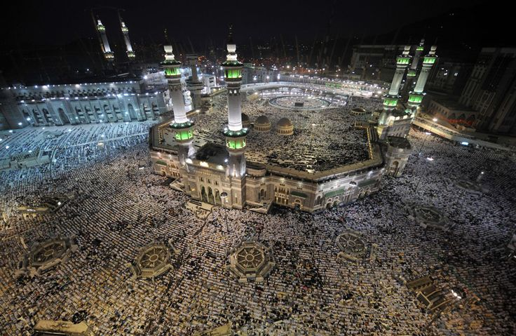 Pilgrims perform evening prayers in Mecca's Grand Mosque on October 8, 2013, as more than two million Muslims arrived in the holy city for the annual Hajj pilgrimage. (Fayez Nureldine/AFP/Getty Images)