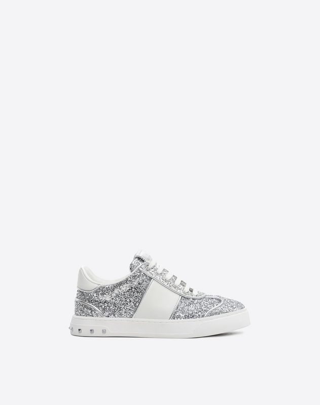 Are you looking for Valentino Garavani Flycrew Sneaker? Find out all the details at Valentino Online Boutique and shop designer icons to wear.