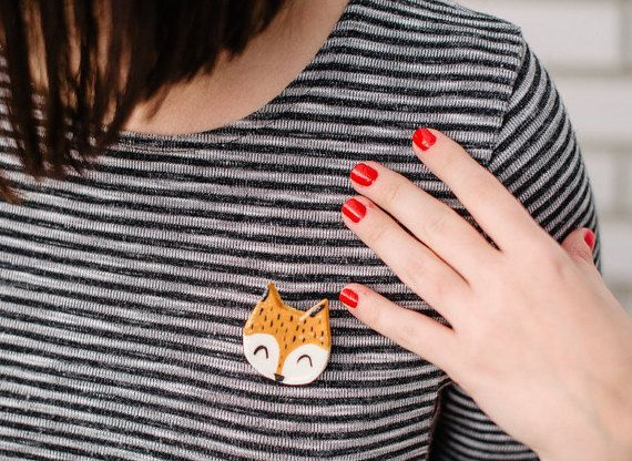 This lovely Fox brooch is hand formed of white clay, fired 1000C*, hand drawn with pigments, glazed and again fired on 1100C*. On the back is a