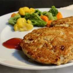 Grandma's Famous Salmon Cakes Recipe - Simple and tasty pan fried salmon cakes! Just salmon, eggs, onion and black pepper. Mix it all up, shape into patties and you are ready to go! Great with macaroni and cheese.
