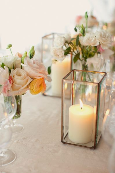Candles and mixed floral arrangements create the perfect setting for romantic wedding tables.