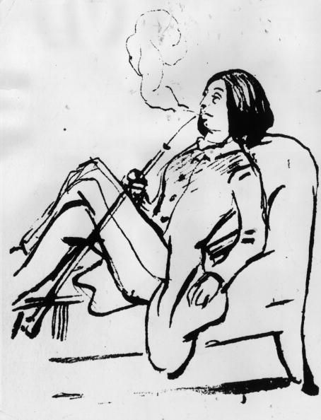 George Sand smoking a pipe and wearing typically masculine dress, circa 1835, by Hulton.