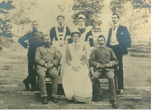 The camp hospital staff with Lt Col Robinson MCO, Hospital Matron Mrs E Meyer and the camp superintendent Berrymann Graumann sitting in front and the camp matron, Mrs Beukes, nurse Potgieter and chief commissariat Arthur Sheperd standing at the back. Barberton Concentration Camp