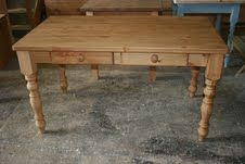 Beautiful hand made solid pine table with 2 handy drawers: http://www.pinefarmhousetable.co.uk/