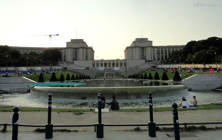 The Palais de Chaillot looking over the Jardins du Trocadero just as the sun is setting.  You may also like www.eutouring.com/images_palais_de_chaillot.html
