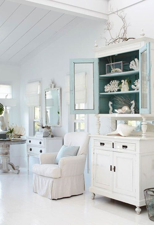 White, monochromatic decor that's deocrated with coatsal inspired details