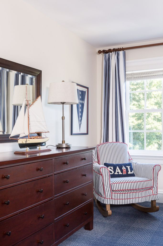 Boy's Nautical Inspired Bedroom by Reed & Acanthus Interior Design: framed  nautical flag, sailboat