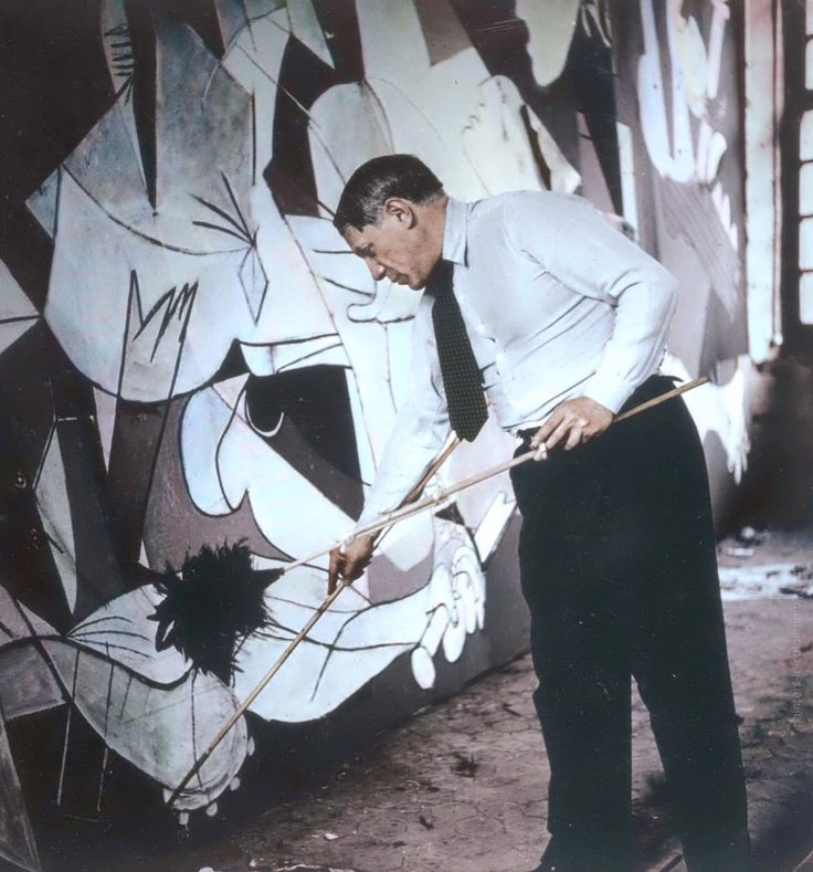 "Pablo Picasso working on ""Guernica"", 1937. Photo by Dora Maar, colorized by painters-in-color"