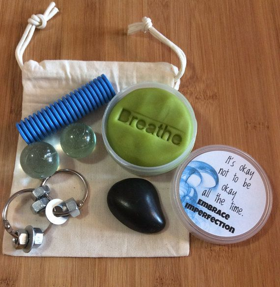 This calm down kit is full of easily portable sensory fidget items, perfect size to have with you on the go or at your desk so its there when you need it. Included in the linen drawstring bag is: A smooth black rock, each rock will be different but will be a nice size to fit in your palm and be smooth to run your thumb over. A ridged tube. You can roll it between your palms or run your finger or thumb. Metal ring fidget with nuts and bolts. 2 handblown glass marbles. Aromatherapy stress…