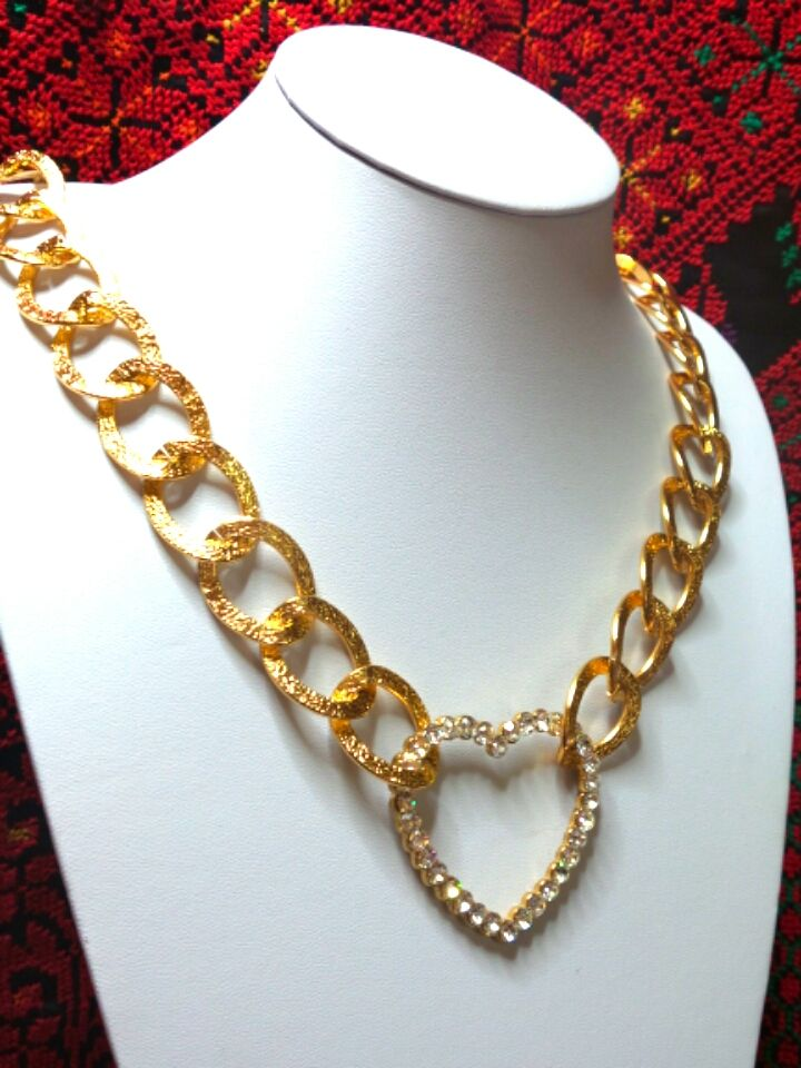 Golden chain necklace with a heart