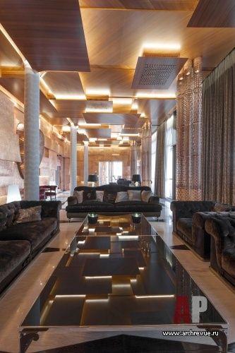 Фото интерьера гостиной дома в стиле авангард. Дизайн интерьера, загородный дом, архитектура