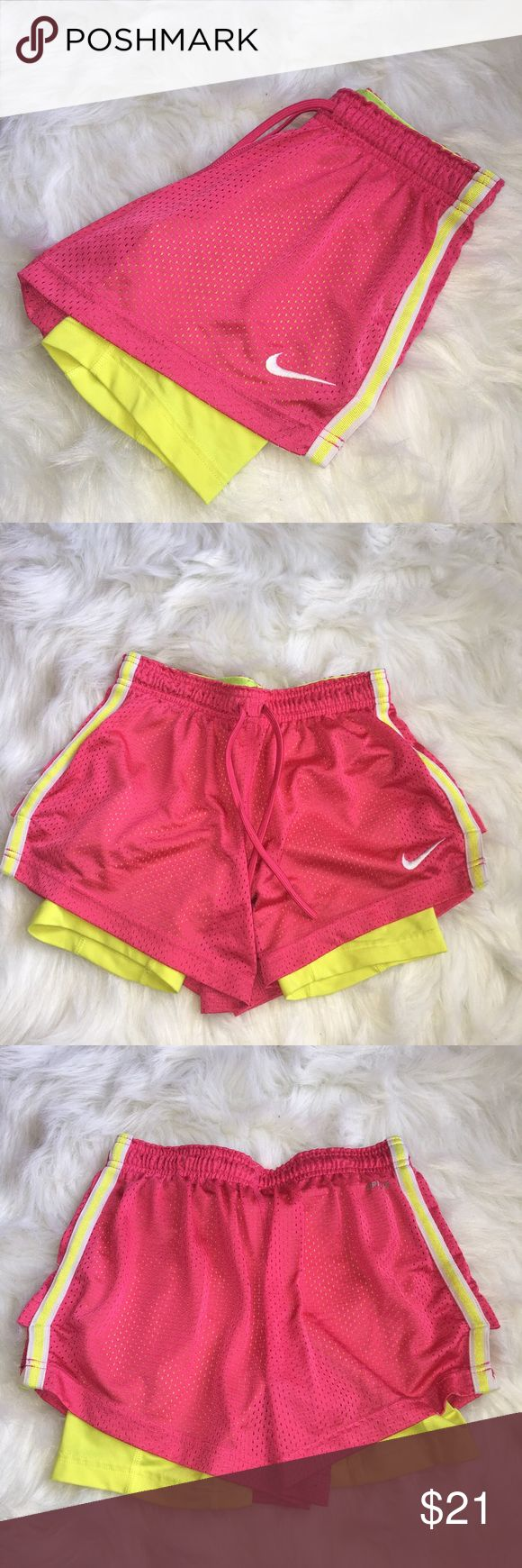 Nike dri-fit shorts with spandex Super cute Nike dri-fit shorts with spandex underneath. Awesome for the gym or running (you won't have to keep tugging at your shorts) they won't ride up! Can't find these anywhere anymore. Nike Shorts