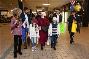 WEB Syrian Refugees Arrive in Pittsburgh Case workers from Jewish Family and Children Services and friends walk with Kholoud Alteara, 29, as she holds the hand of her son, Mohmad, 9, and her daughter, Mays, 8, on Tuesday at Pittsburgh International Airport.